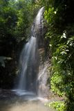 Waterfall in deep forest at island Koh Lanta Thailand Stock Photos