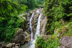 Waterfall in deep forest at mountains Stock Photography
