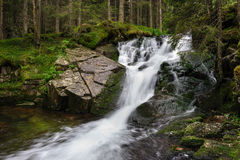 Waterfall in deep forest at mountains Stock Photos