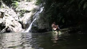 Waterfall in deep forest stock video