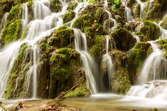 Waterfall in deep forest in Plitvice national park Royalty Free Stock Photography