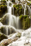 Waterfall in deep forest in Plitvice national park Royalty Free Stock Photo
