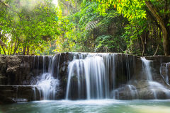 Waterfall deep forest scenic natural sunlight Royalty Free Stock Photo
