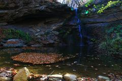 Waterfall in forest autumn view royalty free stock image