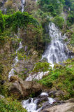 Waterfall in deep rain forest jungle Stock Image