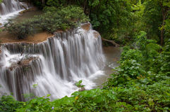 Waterfall in deep rain forest jungle. Stock Photo