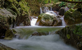 Waterfall in deep rain forest jungle Stock Photo