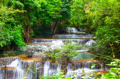Waterfall in deep rain forest jungle (Huay Mae Kamin Waterfall i Stock Photo