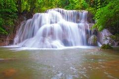 Waterfall in deep rain forest jungle (Huay Mae Kamin Waterfall i Stock Images