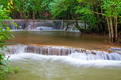 Waterfall in deep rain forest jungle (Huay Mae Kamin Waterfall i Stock Photos