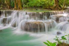 Waterfall in deep rain forest jungle (Huay Mae Kamin Waterfall i Stock Photo