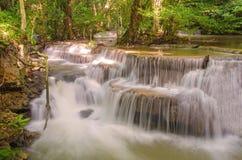 Waterfall in deep rain forest jungle (Huay Mae Kamin Waterfall Stock Image