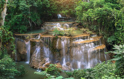 Waterfall in deep rain forest jungle (Huay Mae Kamin Waterfall stock photography
