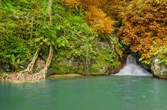 Waterfall in deep rain forest jungle. Krok E Dok Waterfall Royalty Free Stock Photo