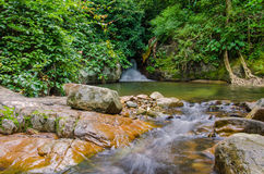 Waterfall in deep rain forest jungle. Krok E Dok Waterfall Royalty Free Stock Photos