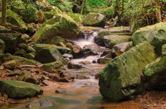 Waterfall in deep rain forest jungle. Krok E Dok Waterfall Stock Photos