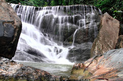 Waterfall in deep rain forest jungle. Stock Photo