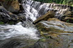 Waterfall in deep rain forest jungle. Royalty Free Stock Image