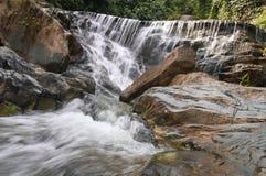 Waterfall in deep rain forest jungle. (Mae pool Waterfall in Utt Stock Image