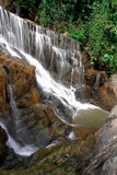 Waterfall in deep rain forest jungle. (Mae pool Waterfall in Utt Royalty Free Stock Photos