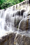 Waterfall in deep rain forest jungle. (Mae pool Waterfall in Utt Stock Photos