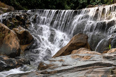 Waterfall in deep rain forest jungle. (Mae pool Waterfall in Utt Stock Images