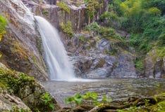 Waterfall in deep rain forest jungle. (Mae Re Wa Waterfalls Moko Stock Photo