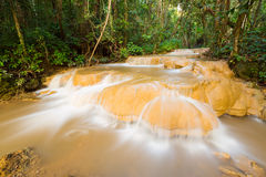 Waterfall in deep rain forest Stock Photos