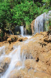 Waterfall in deep rainforest Stock Images