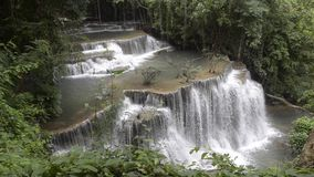 Waterfall in deep tropical rain forest, Kanchanaburi, Thailand stock video footage