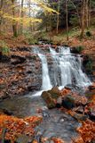 Waterfall in Derbyshire Peak District in Autumn. Autumn colours in the Peak District of Derbyshire around a waterfall Stock Photos