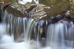 Waterfall detail. Closeup detail of a waterfall landing into pool Stock Images