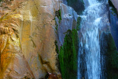 Waterfall. Detail of small waterfall with rocks and green vegetation Stock Image