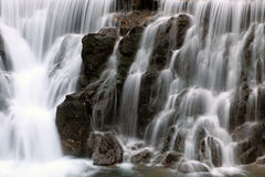 Waterfall. Details of flowing water and stones Royalty Free Stock Photography
