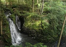 Waterfall the wild swoosh in wild Endertal valley in eifel regio. Waterfall die wilde rausch engl. the wild swoosh in wild Endertal valley in eifel region Stock Images