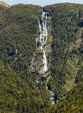 Waterfall in Doubtful Sound in New Zealand Stock Images