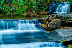 Waterfall down the Carreck Creek. Table Rock State Park, South Carolina Stock Photography