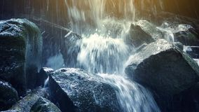 Waterfall With Dramatic Sun Flare stock video footage