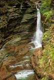 Waterfall drops into Glen Gorge in State Park. Waterfall drops into Glen Gorge in Watkins Glen State Park royalty free stock image
