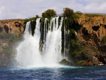 Waterfall Duden. At Antalya, Turkey. Nature travel background. Clear sea and blue sky in summer Royalty Free Stock Photos