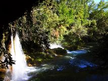 Waterfall Duden, Antalya. Park Duden in Antalya, Turkey. Looking to the waterfall from the cave. Nature travel background Royalty Free Stock Photos