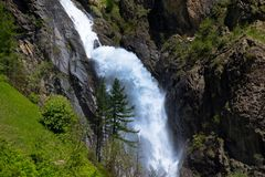Waterfall in the Ecrins National Parc in France. Dormillouse waterfall in the Ecrins National Parc in the Hautes Alpes in France royalty free stock photo