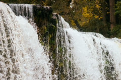 Waterfall edge closeup against autumnal forest Stock Photography