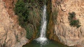 Waterfall from ein gedi splashing. Video of waterfall from ein gedi splashing stock footage