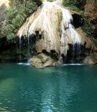 Waterfall emerald water in the Thailand stock image