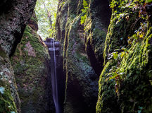 Waterfall at the end of the Dragon canyon near Wartburg in Germany Royalty Free Stock Photo