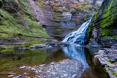 Waterfall on Enfield Creek, NY. A pool in one of the greatest gorges in the Ithaca area holds numerous small trout Stock Image