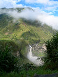Waterfall in equatorial rainforest. With clouds covering mountain tops, in Ecuador, South America stock photography