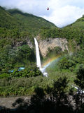 Waterfall in equatorial rainforest, with rainbow. Over fall, in Ecuador, South America royalty free stock photos