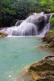 Waterfall in Erawan National Park with fish Stock Photography